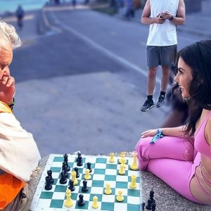 Street Worker And Rave Girl Play Chess